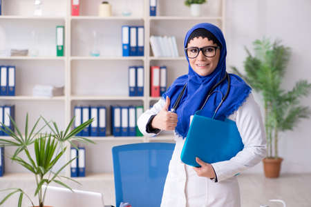 Female doctor in hijab working in the hospital Stock Photo