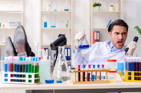 Young male chemist working in the lab Stock Photo
