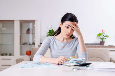 Young woman in budget planning concept