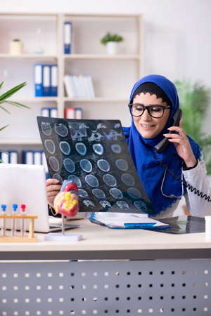 Female doctor in hijab working in the hospital Фото со стока