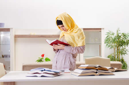 Female student in hijab preparing for exams Фото со стока