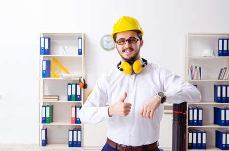 Young male architect working in the office