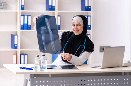 Young doctor in hijab working in the clinic Stockfoto