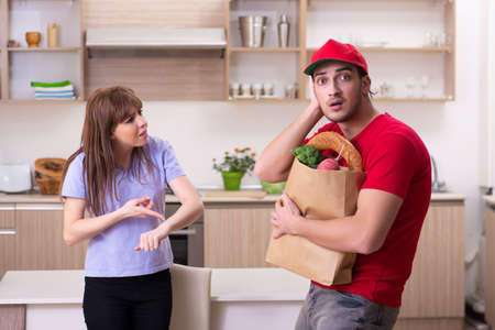 Young male courier in food delivery concept Foto de archivo - 124852173