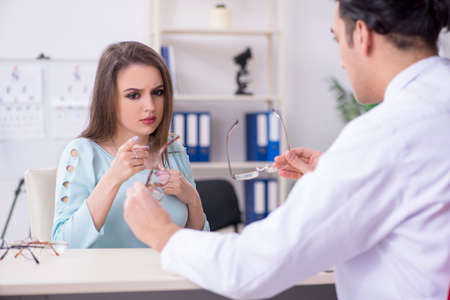 Young woman visiting male doctor oculist Stock Photo