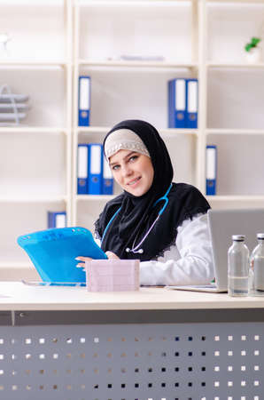 Young doctor in hijab working in the clinic Stock Photo