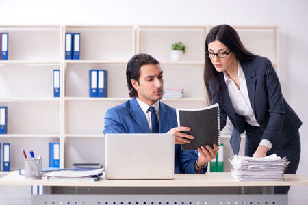 Two employees working in the office Stockfoto