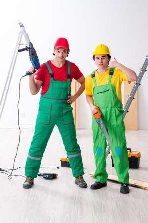 Two workers contractors working indoors