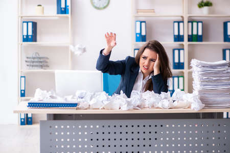 Businesswoman rejecting new ideas with lots of papers Stockfoto