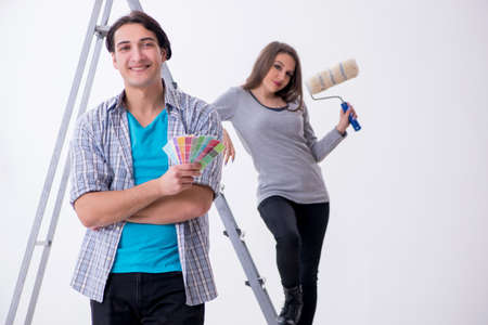 Young family doing renovation at home