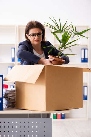 Middle-aged female employee being fired from her work