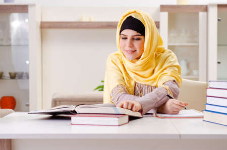 Female student in hijab preparing for exams Imagens