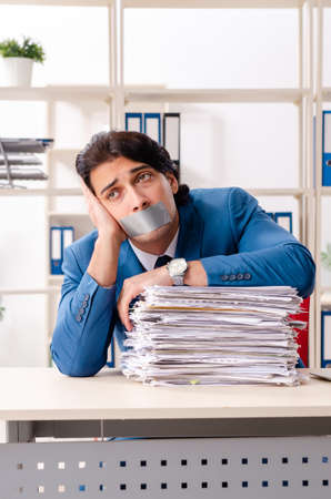 Young male employee with tape on the mouth Stockfoto - 125327924
