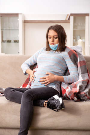 Sick pregnant woman suffering at home Reklamní fotografie