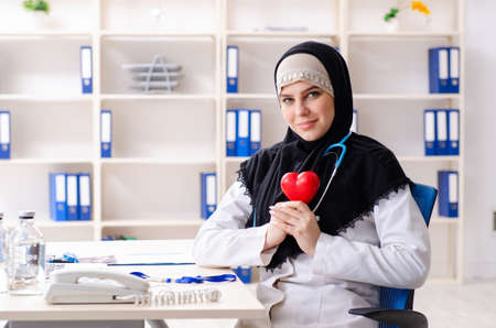 Young doctor in hijab working in the clinic Reklamní fotografie