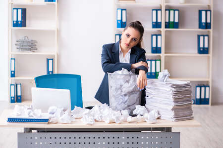 Businesswoman rejecting new ideas with lots of papers Reklamní fotografie