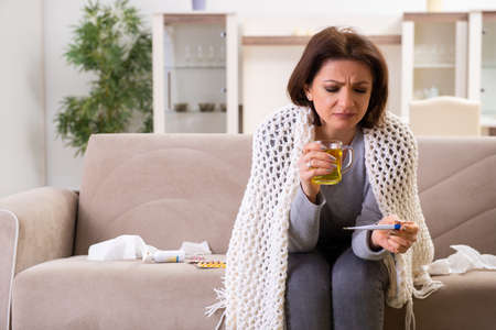 Sick middle-aged woman suffering at home