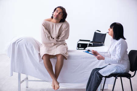 Old female psychiatrist visiting young male patient