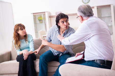 Young pair visiting experienced doctor psychologist