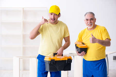 Two contractors carpenters working indoors Zdjęcie Seryjne