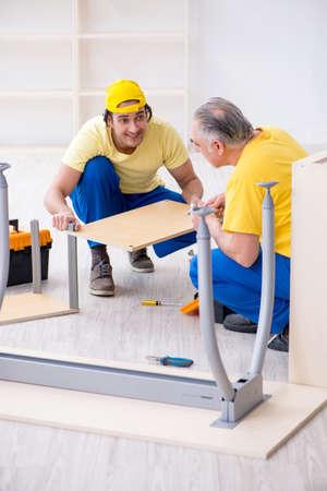 Two contractors carpenters working indoors Stock Photo