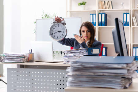 Beautiful female employee unhappy with excessive work