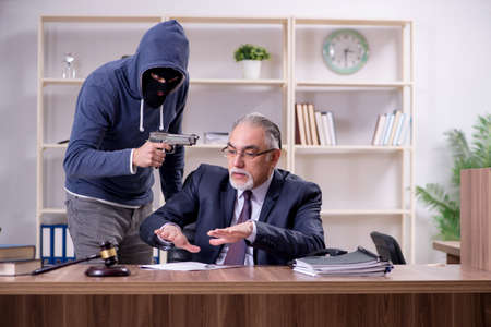 Young mobster threatening old judge