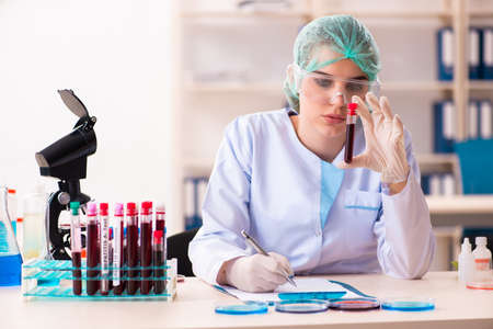 Young female chemist working in the lab Reklamní fotografie