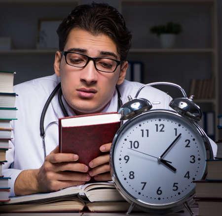 Medical student preparing for university exams at night 版權商用圖片