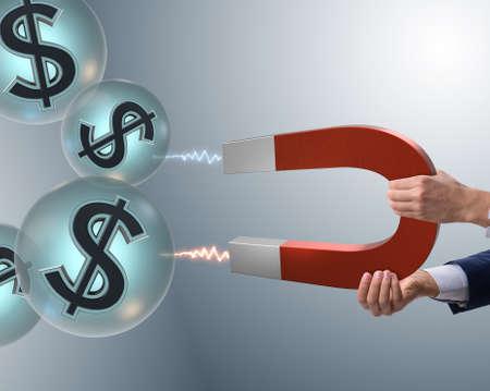 Zakenman die dollars op hoefijzermagneet vangt Stockfoto