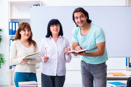 Old teacher and students in the classroom