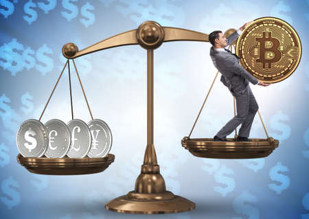 Businessman on scales with bitcoins and other currencies