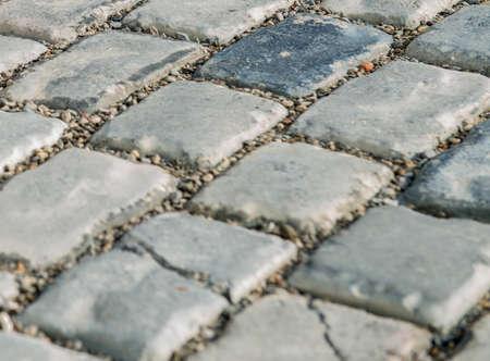 Straße gepflastert mit Kopfsteinpflaster für Ihren Hintergrund