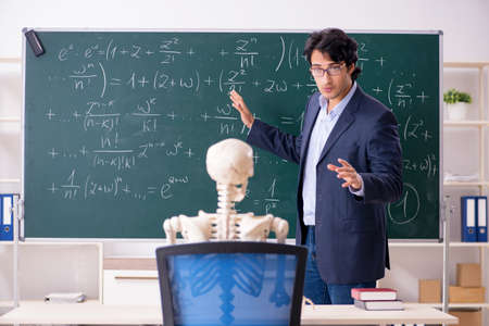 Young male math teacher and student skeleton Archivio Fotografico