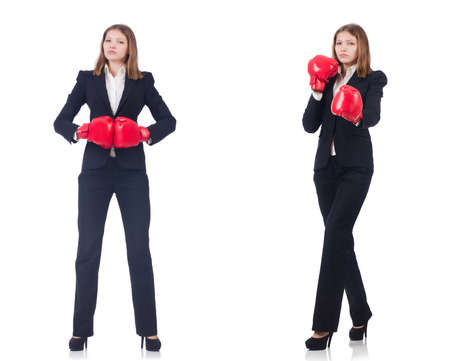 Businesswoman with boxing gloves isolated on a white background Stock Photo