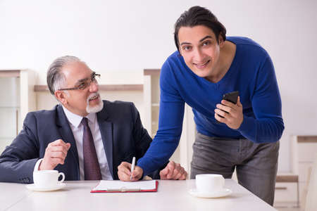 Male real estate agent and male client in the apartment