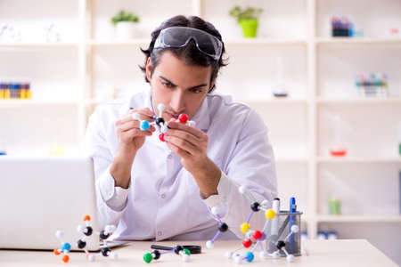 Young male scientist working in the lab