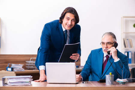 Young and old employees working together in the office