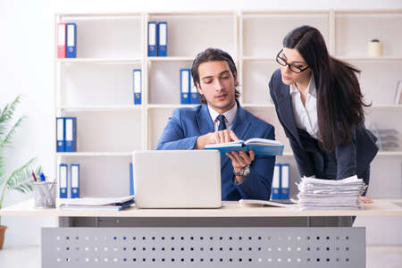 Two employees working in the office Stock Photo