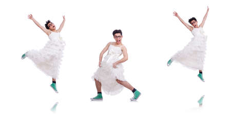 Funny dancing man wearing in woman dress isolated on white Banco de Imagens