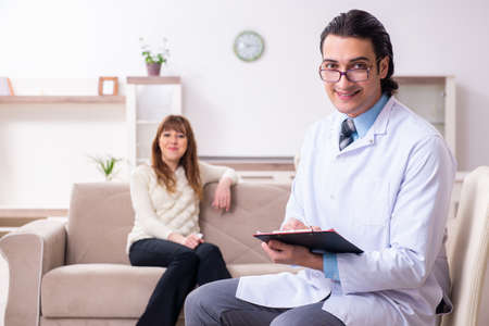 Young female patient discussing with male psychologist personal
