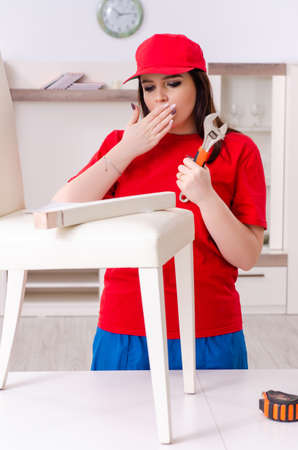 Young woman repairing chair at home