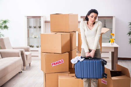 Young woman moving to new flat