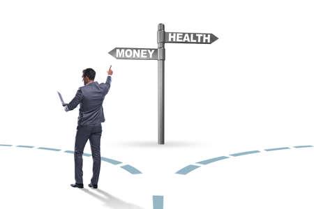 Businessman choosing between money and health 스톡 콘텐츠