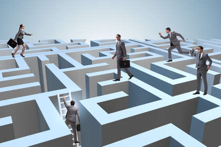 Business people trying to escape from maze