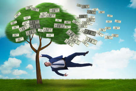 Businessman blown away from the money tree