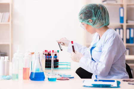 Young female chemist working in the lab