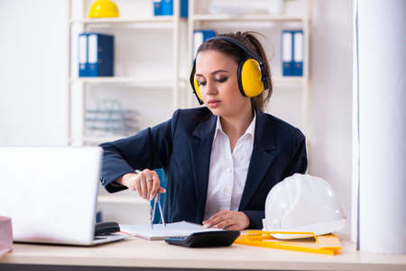 Young female architect working in the office