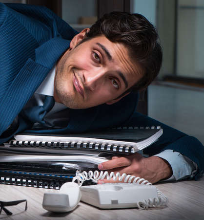 Businessman working overtime long hours late in office Stockfoto