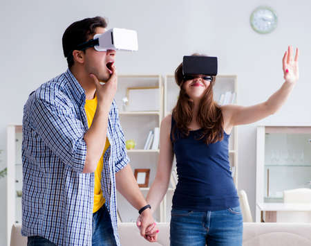 Young family playing games with virtual reality glasses Foto de archivo